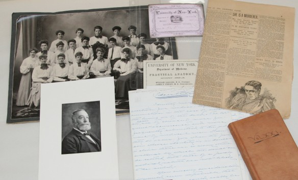 Spread of photographs, clippings, and other documents from MacDonald Papers