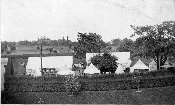 Black and white photograph of tent city and grounds from a New York psychiatric facility dated 1901