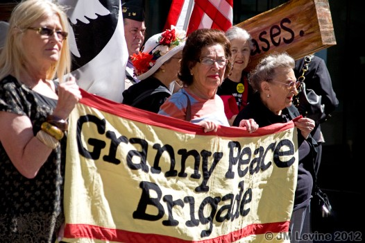 "3 women carrying a banner saying ""Granny Peace Brigade"""