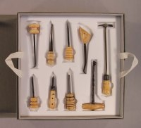 9 ivory-handled dental instruments in custom fit tray