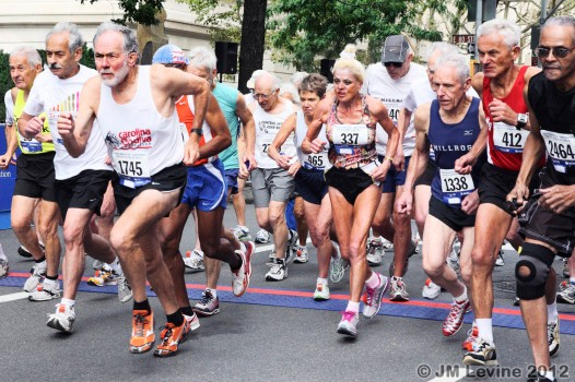 Group of runners running in the Over 70 Race
