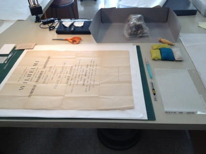 Repairing paper certificates in the conservation lab.