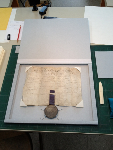 A certificate and seal, re-housed.