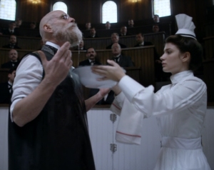 Dr. Christiansen (Matt Frewer) preps his beard for surgery, assisted by Nurse Elkins (Eve Hewson). Courtsey of HBO-Cinemax.