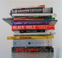 Stack of medically-themed graphic novels. Photo by Ian Williams.