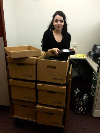 Intern Michelle Krause with audio-visual materials in the library's collection.