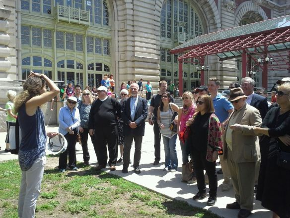 Our Save Ellis Island tour guide gives safety instructions before the group enters the hospital zone.