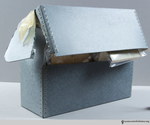 A damaged document box housing health pamphlets.