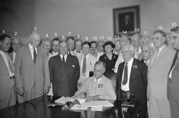 Roosevelt signing the Social Security Act, 1935. See here for names of participants. Courtesy of the Social Security Administration.