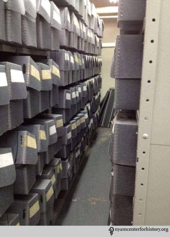 Previous storage space, with overstuffed document boxes.