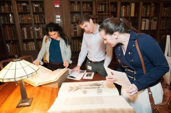 Visitors looking at books on display at 2014's Vesalius 500 festival.