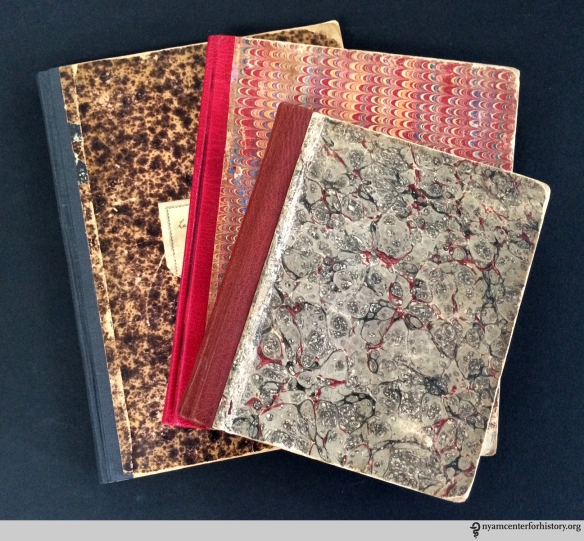 Three ready-made notebooks after conservation treatment.