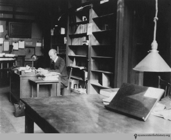 """""""Frank Place in Reading Room as moving was going on,"""" 1926, 17 West 43rd St."""