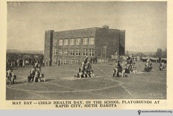 May Day - Child Health Day, on the school playgrounds at Rapid City, South Dakota. In The Goal of May Day, 1928.