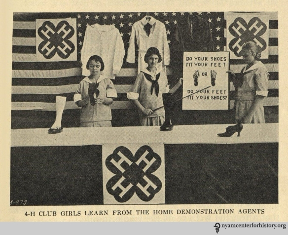 """4-H girls club learn from the home demonstration agents."" In The Goal of May Day, 1928."