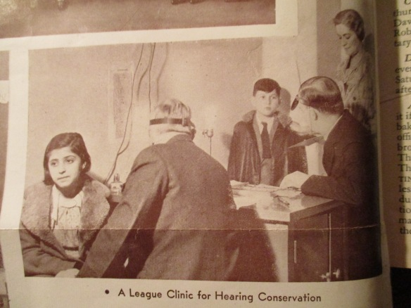 Promotional photo by the New York League for the Hard of Hearing and its hearing clinic for testing and examination (The Bulletin, Dec. 1935)